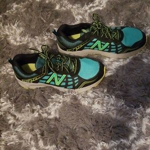 New balance teal and black running shoes